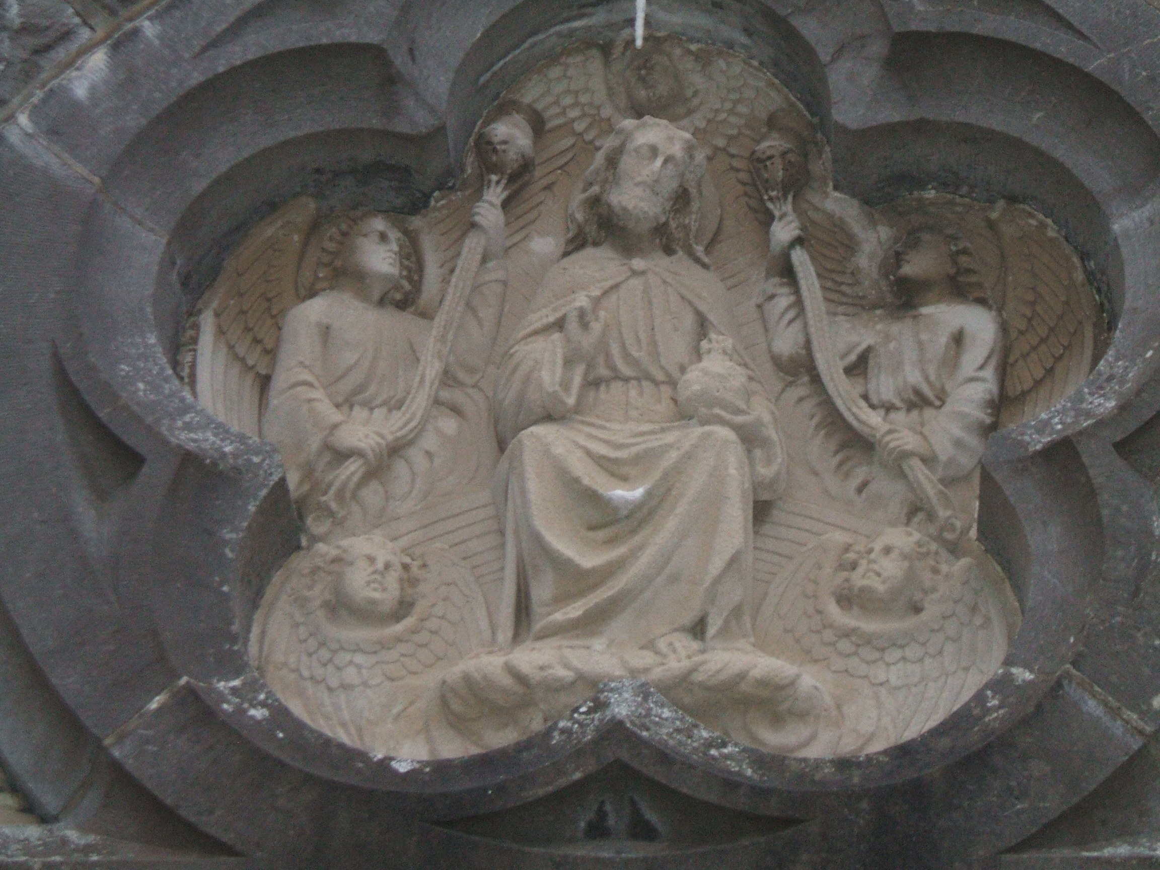 Image of Christ the King over entrance to St. Clare's Church
